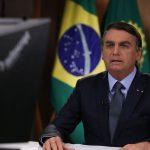#Pracegover Foto: Na imagem há o presidente Jair Bolsonaro com semblante sério em discurso na ONU