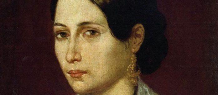 #Pracegover Foto: na imagem há o retrato de uma mulher