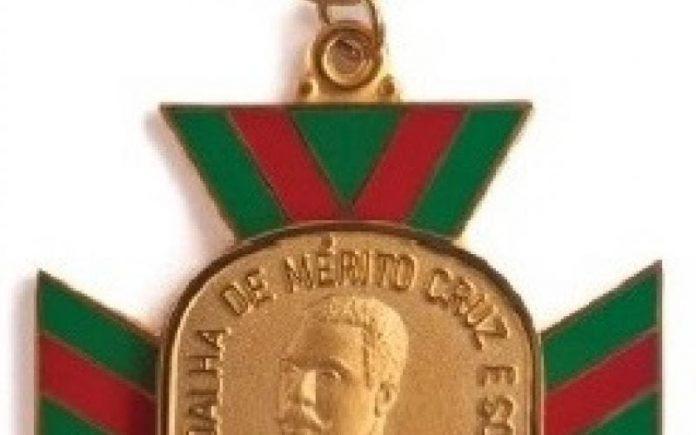 #Pracegover Foto: na imagem há uma medalha