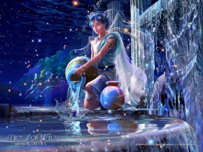#Pracegover Foto: na imagem há uma pessoa na água com bolas (planetas)