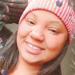 #Pracegover Foto: na imagem há uma mulher sorridente
