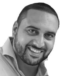 #Pracegover Foto: na imagem há um homem de barba e sorrindo
