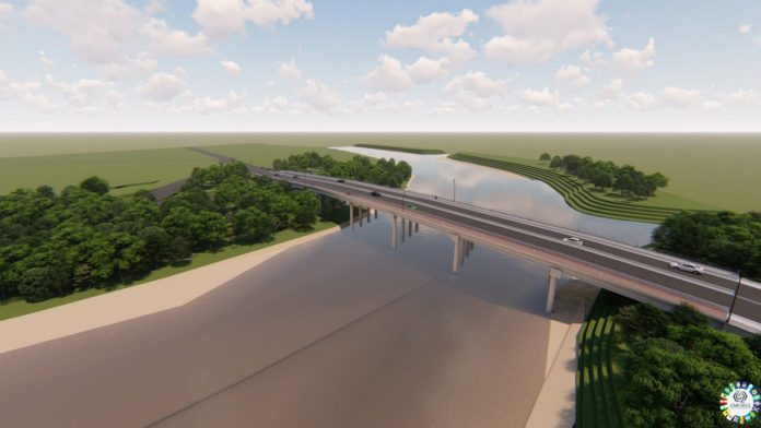 #Pracegover Foto: na imagem há uma ponte, o rio e árvores