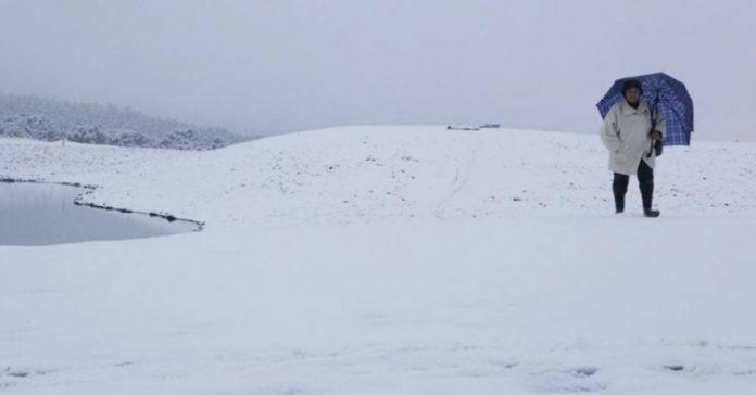 #Pracegover Na foto, paisagem coberta de neve