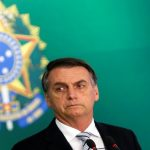 #Pracegover Na foto, Bolsonaro aparece com um semblante sério