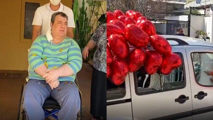 #Pracegover Na foto, à esquerda Gerson Brenner em uma cadeira de rodas e à direita um carro decorado com balões